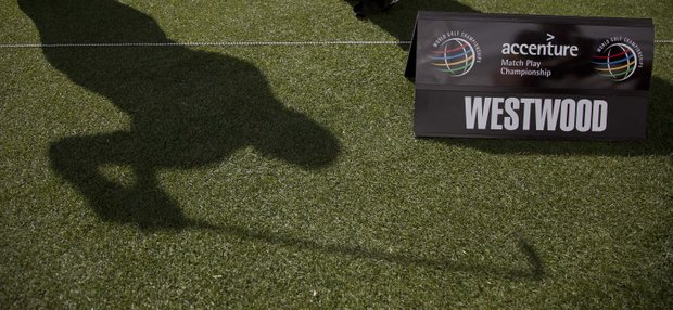 The shadow of England's Lee Westwood is cast on the grass as he practices on the driving range for the Match Play Championship, Monday, Feb. 20, 2012, in Marana, Ariz.