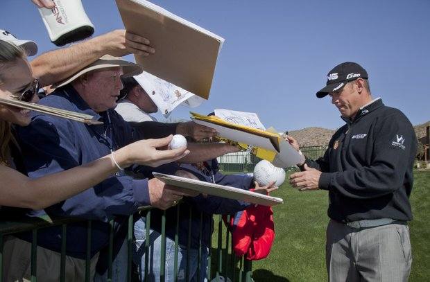 England's Lee Westwood signs autographs for fans before hitting on the practice range for the Match Play Championship, Monday, Feb. 20, 2012, in Marana, Ariz.