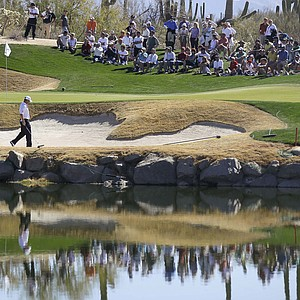 England's Lee Westwood approaches his ball in the bunker on three while playing Nick Watney during the Match Play Championship golf tournament, Friday, Feb. 24, 2012, in Marana, Ariz.