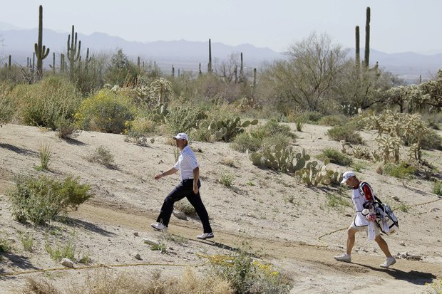 Lee Westwood, of England, walks through the rough along the sixth fairway while playing Nick Watney during the Match Play Championship golf tournament, Friday, Feb. 24, 2012, in Marana, Ariz.