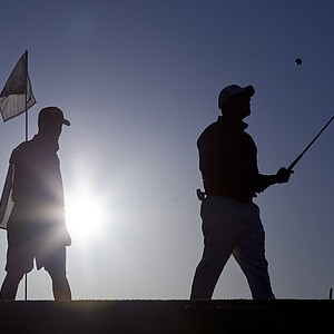 England's Lee Westwood tosses his ball up after missing a putt on the first green while playing Rory McIlroy of Northern Ireland during the Match Play Championship golf tournament, Sunday, Feb. 26, 2012, in Marana, Ariz.