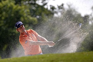 Webb Simpson hits out of a bunker during the first round of the Zurich Classic golf tournament at TPC Louisiana in Avondale, La., Thursday, April 26, 2012.