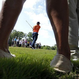 Webb Simpson hits from amongst spectators on the edge of a fairway during the first round of the Zurich Classic golf tournament at TPC Louisiana in Avondale, La., Thursday, April 26, 2012.