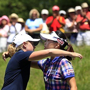 Stacy Lewis, left, hugs Sun Young Yoo, of South Korea, on the 18th hole after their third round match in the LPGA Sybase Match Play Championship golf competition at Hamilton Farm Golf Club in Gladstone, N.J., Saturday, May 19, 2012. Lewis won 1-up.