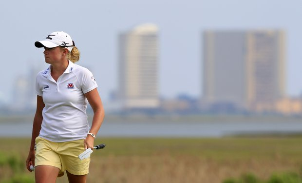 Atlantic City can be seen in the background as Stacy Lewis walks along the 15th hole during the second round of the LPGA ShopRite Classic golf competition at Stockton Seaview Hotel and Golf Club in Galloway Township, N.J., Saturday, June 2, 2012. Lewis is 12-under-par, 130 through two rounds
