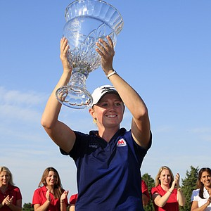 Stacy Lewis holds up the winner's trophy on the 18th hole after winning the LPGA ShopRite Classic golf competition at Stockton Seaview Hotel and Golf Club in Galloway Township, N.J., Sunday, June 3, 2012. Lewis finished 12-under-par, 201 for the tournament.