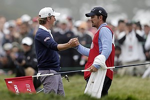 Webb Simpson is congratulated by his caddie Paul Tesori after putting on the 18th hole during the fourth round of the U.S. Open Championship golf tournament Sunday, June 17, 2012, at The Olympic Club in San Francisco.