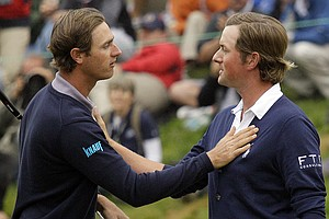 Webb Simpson, right, is congratulated by Nicolas Colsaerts, of Belgium, after their the fourth round of the U.S. Open Championship golf tournament Sunday, June 17, 2012, at The Olympic Club in San Francisco.