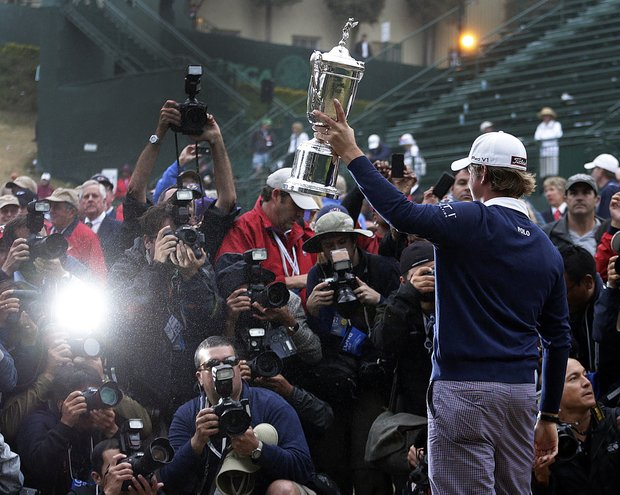 Webb Simpson posses with the championship trophy after the U.S. Open Championship golf tournament Sunday, June 17, 2012, at The Olympic Club in San Francisco.