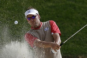 Europe's Ian Poulter hits out of a bunker on the 15th hole during a practice round at the Ryder Cup PGA golf tournament Thursday, Sept. 27, 2012, at the Medinah Country Club in Medinah, Ill.