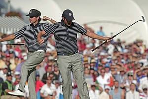 USA's Webb Simpson, right, and Bubba Watson react after Simpson made a putt to with the 13th hole during a four-ball match at the Ryder Cup PGA golf tournament Saturday, Sept. 29, 2012, at the Medinah Country Club in Medinah, Ill.