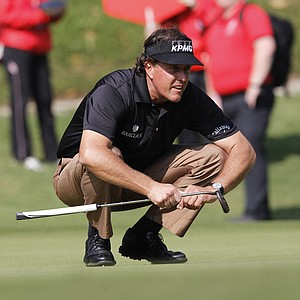 Phil Mickelson of the U.S. lines a putt at the 11th hole during the first round of the WGC-HSBC Champions golf tournament in Dongguan, southern China's Guangdong province, Thursday Nov. 1, 2012.