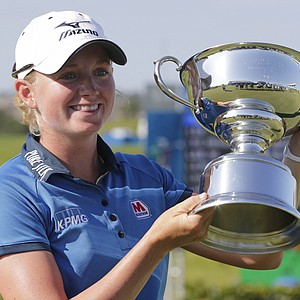 Stacy Lewis displays the trophy after winning the Navistar LPGA Classic golf tournament on Sunday, Sept. 23, 2012, at the Robert Trent Jones Golf Trail in Prattville, Ala.
