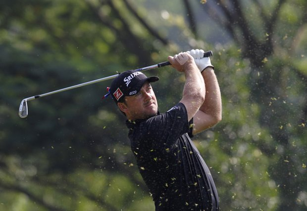 Graeme McDowell from Northern Ireland tees off at the 7th hole during the second round of the HSBC Champions golf tournament in Dongguan, southern China's Guangdong province, Friday, Nov. 2, 2012.
