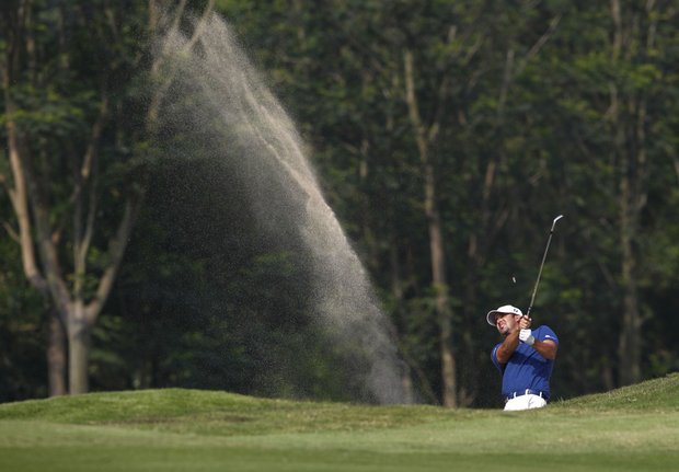 Scott Piercy from the United States hits a bunker shot on the 14th hole during the HSBC Champions golf tournament in Dongguan, southern China's Guangdong province, Sunday, Nov. 4, 2012.