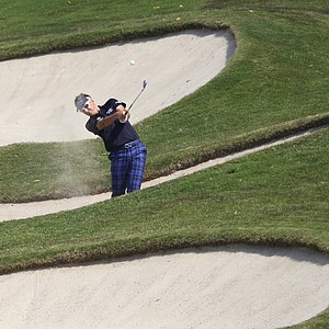 Ian Poulter from England hits a bunker shot at the 9th hole during the third round of the HSBC Champions golf tournament in Dongguan, southern China's Guangdong province, Saturday Nov. 3, 2012.