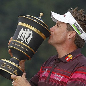 Ian Poulter from England holds the trophy as he poses for the photographers after winning the HSBC Champions golf tournament in Dongguan, southern China's Guangdong province, Sunday Nov. 4, 2012.
