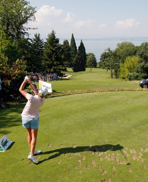 Stacy Lewis of USA plays on the seventeenth hole during the first round of the Evian Masters women's golf tournament in Evian, eastern France, Thursday, July 26, 2012.