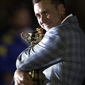Europe's Ian Poulter hugs the trophy after winning the Ryder Cup PGA golf tournament Sunday, Sept. 30, 2012, at the Medinah Country Club in Medinah, Ill.