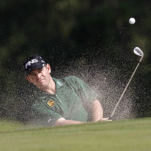 Louis Oosthuizen from South Africa hits the bunker shot at the 9th hole during the round 2 match of the WGC- HSBC Champions golf tournament in Dongguan, southern China's Guangdong province, Friday Nov. 2, 2012.