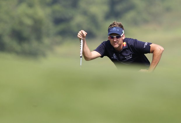 Ian Poulter from England lines a putt at the 9th hole during the the third round of the HSBC Champions golf tournament in Dongguan, southern China's Guangdong province, Saturday Nov. 3, 2012.