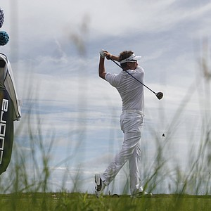 Ian Poulter of England watches his drive from the 12tee during a practice round for the PGA Championship golf tournament on the Ocean Course of the Kiawah Island Golf Resort in Kiawah Island, S.C., Wednesday, Aug. 8, 2012.