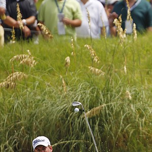 Webb Simpson chips to the eighth green during the first round of the PGA Championship golf tournament on the Ocean Course of the Kiawah Island Golf Resort in Kiawah Island, S.C., Thursday, Aug. 9, 2012.