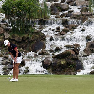 Stacy Lewis of the United States makes a putt on 15th green during the first round of the LPGA Malaysia golf tournament at Kuala Lumpur Golf and Country Club in Kuala Lumpur, Malaysia, Thursday, Oct. 11, 2012.