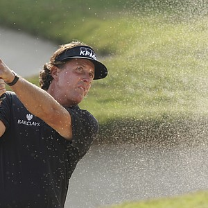 Phil Mickelson from the United States hits the bunker shot on the 15th hole during the HSBC Champions golf tournament in Dongguan, southern China's Guangdong province, Sunday Nov. 4, 2012.