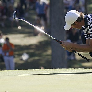 USA's Webb Simpson reacts after missing a putt on the 12th hole during a singles match at the Ryder Cup PGA golf tournament Sunday, Sept. 30, 2012, at the Medinah Country Club in Medinah, Ill.