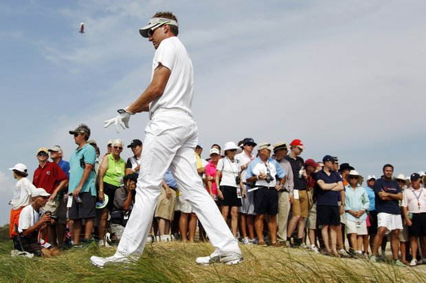 Ian Poulter, of England, walks past the gallery along the 13th hole during the final round of the PGA Championship golf tournament on the Ocean Course of the Kiawah Island Golf Resort in Kiawah Island, S.C., Sunday, Aug. 12, 2012.