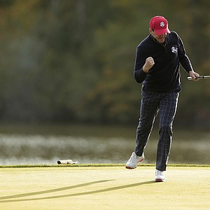 USA's Keegan Bradley reacts as he sinks a putt on the second hole to win the hole during a foursomes match at the Ryder Cup PGA golf tournament Friday, Sept. 28, 2012, at the Medinah Country Club in Medinah, Ill.