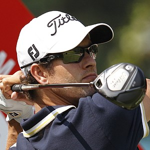 Adam Scott from Australia tees off at the 12th hole during the first round of the WGC-HSBC Champions golf tournament in Dongguan, southern China's Guangdong province, Thursday Nov. 1, 2012.