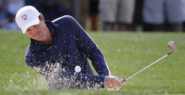 USA's Keegan Bradley hits out of a bunker on the fourth hole during a practice round at the Ryder Cup PGA golf tournament Wednesday, Sept. 26, 2012, at the Medinah Country Club in Medinah, Ill.