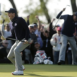 USA's Keegan Bradley reacts after making a putt on the ninth hole during a foursomes match at the Ryder Cup PGA golf tournament Saturday, Sept. 29, 2012, at the Medinah Country Club in Medinah, Ill.