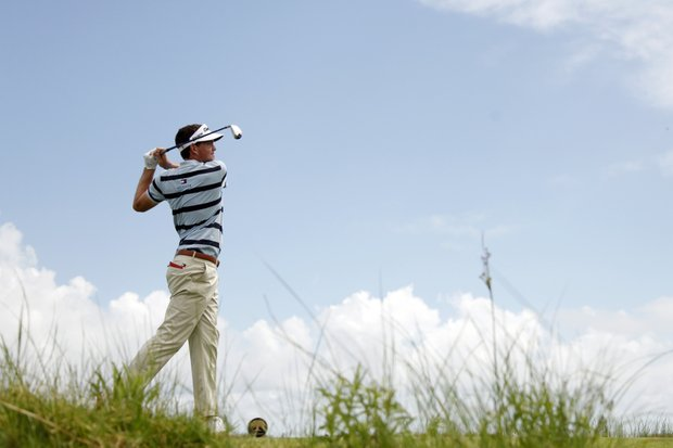 Keegan Bradley watches his drive from the 14th tee during a practice round for the PGA Championship golf tournament on the Ocean Course of the Kiawah Island Golf Resort in Kiawah Island, S.C., Tuesday, Aug. 7, 2012.