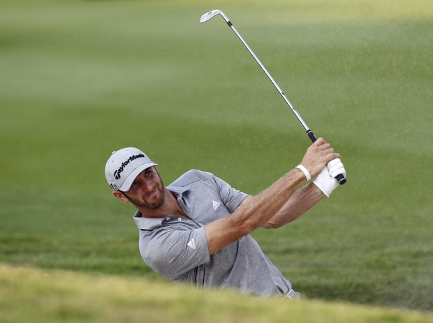 Dustin Johnson of the U.S. hits a bunker shot at the 18th hole during the round 2 match of the HSBC Champions golf tournament in Dongguan, southern China's Guangdong province, Friday Nov. 2, 2012.