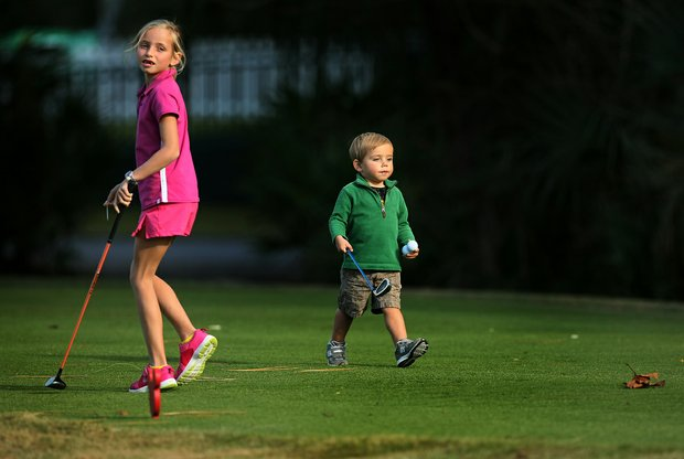 Sky Leonard, 2, heads to the tee to hit his ball after his big sister, Reese, 9, during the PGA Tour Father/Child Tournament on the Oak Trail Course. They are the children of PGA Tour player Justin Leonard.