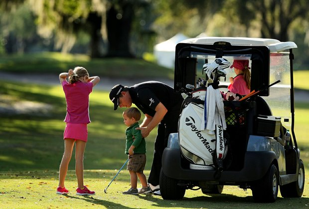 Justin Leonard with three of his children, Reese, 9, Sky, 2, and Avery, 7, far right, during the PGA Tour Father/Child Tournament on the Oak Trail Course.