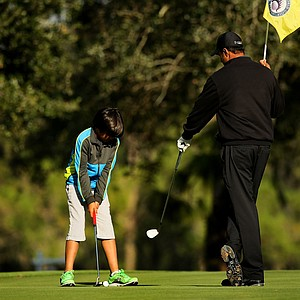 PGA Tour player Arjun Atwal with his son Krishen, 8, during the PGA Tour Father/Child Tournament on the Oak Trail Course.