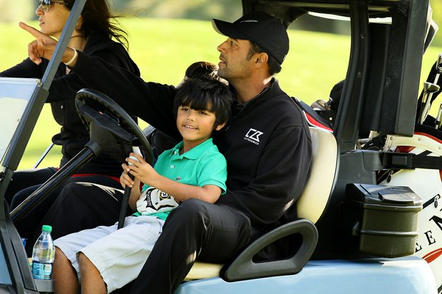 PGA Tour player Arjun Atwal with his son, Shiva, 4, and his wife Sona during the PGA Tour Father/Child Tournament on the Oak Trail Course. Atwal also played with his older son, Krishen, 8.