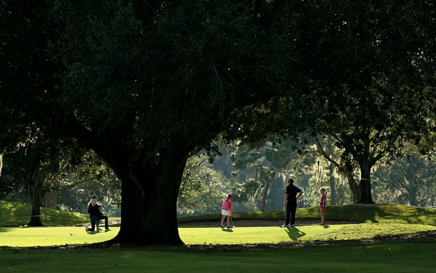 Justin Leonard with his family during the PGA Tour Father/Child Tournament on the Oak Trail Course.