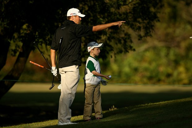PGA Tour player Sean O'Hair with his son Luke, 5, during the PGA Tour Father/Child Tournament on the Oak Trail Course. O'Hair played with his son and daughter, Molly, 7.