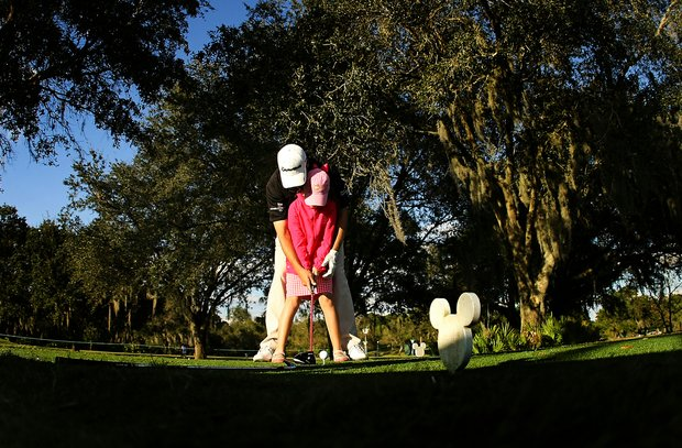 PGA Tour player Sean O'Hair lines up his daughter, Molly, 7, on the final hole during the PGA Tour Father/Child Tournament on the Oak Trail Course.