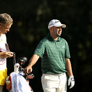Josh Teater discusses club selection with his caddie at No. 18 on the Magnolia Course during the Children's Miracle Network Hospitals Classic.