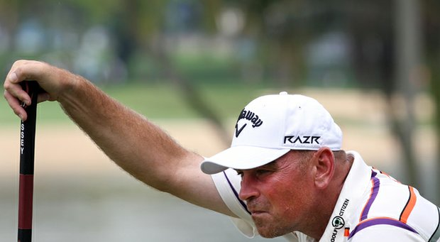 Thomas Bjorn lines up a putt during the second round of the Singapore Open at the Serapong Course at Sentosa Golf Club.