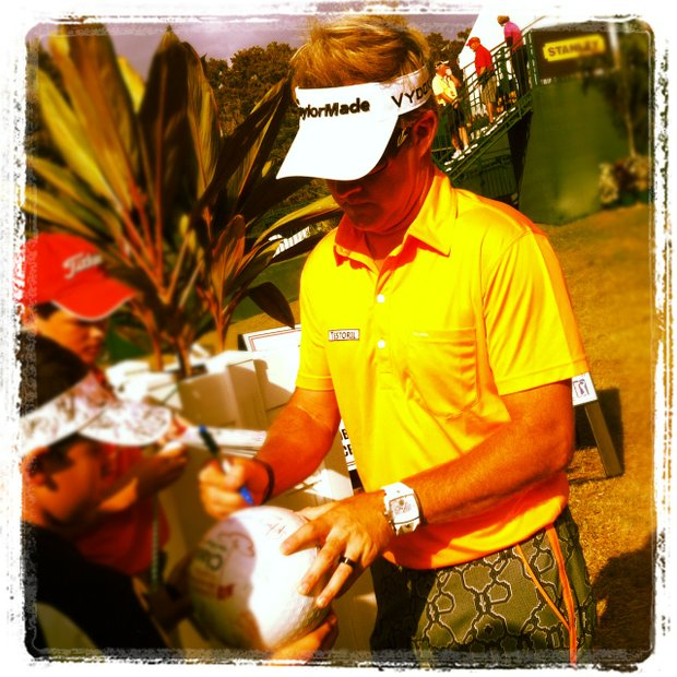 Brian Gay signs autographs at No. 18 on the Magnolia Course during the Children's Miracle Network Hospitals Classic.