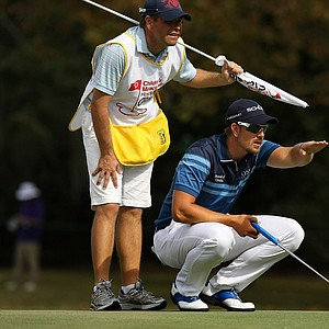 Henrik Stenson with his caddie on the Magnolia Course during the final round of the Children's Miracle Network Hospitals Classic.