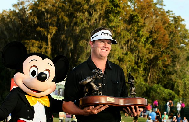 Charlie Beljan and Mickey Mouse on the 18th green of Magnolia Course after he won the Children's Miracle Network Hospitals Classic.