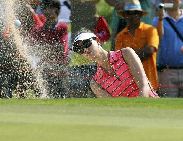 Michelle Wie of the U.S. plays a bunker shot on the first during the final round of the LPGA Thailand golf championship in Pattaya, Chonburi province, southeastern Thailand Sunday, Feb. 19, 2012.
